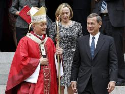 Cardinal Donald Wuerl walks with U.S. Supreme Court Chief Justice John Roberts after the Red Mass at Cathedral of St. Matthew the Apostle in Washington on Sunday. The high court's session began Monday.
