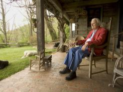 Evangelist Billy Graham relaxes on the porch of his mountaintop cabin in Montreat, N.C., in 2005.