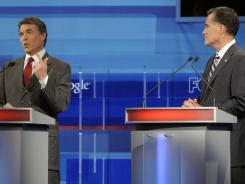 Welcome to Orlando: Texas Gov. Rick Perry, left, and former Massachusetts governor Mitt Romney at the Republican presidential debate Sept. 22.