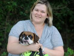Christina McCurdy, a New Jersey school teacher and a Type I diabetic, uses a Diabetic Alert Dog named Jinx to warn her when her blood sugar is dropping or rising.