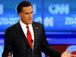 Former Massachusetts governor Mitt Romney debates Texas Gov. Rick Perry Sept. 12 in Tampa. Romney has criticized Perry's positions and policies on immigration.