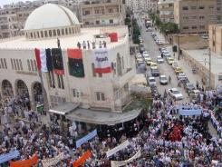 Syrian anti-government demonstrators march during a protest last week.