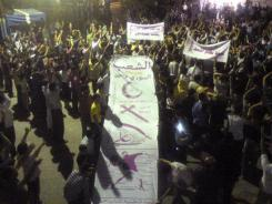 A mobile phone image shows a Monday protest against the Syrian president in Homs province.
