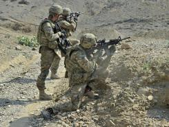 U.S. troops peer through their rifle scopes during a mission along the Afghan-Pakistani border Sept. 30.