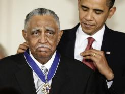 President Obama presents a Presidential Medal of Freedom to Lowery in 2009.