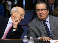 Justices Stephen Breyer and Antonin Scalia testify on Capitol Hill in October.