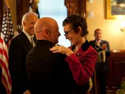 Rep. Gabrielle Giffords with husband Mark Kelly at the White House.