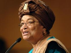 In this Sept. 18, 2006, file photo, Liberian President Ellen Johnson Sirleaf addresses the audience at the Kennedy School of Government at Harvard University in Cambridge, Mass.