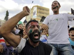 Anti-Syrian regime protesters shout slogans against President Bashar Assad after Friday prayers in Tripoli.