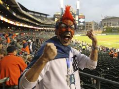 A Detroit Tigers fan gets pumped up before a game against the New York Yankees.