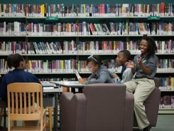 Charnell Hemphill, left, plays on a keyboard while Lauraah McGuire, Dana Jackson and Jara Rollins surf the Web.