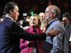 GOP presidential hopeful Mitt Romney greets the audience at the Saturday session of the Values Voter Summit.