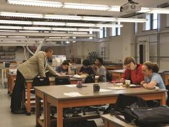 A professor works with students at Smith College.