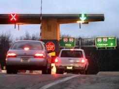 Cars enter the Michigan City exit plaza on the Indiana Toll Road. This year, Indiana has moved to make it easier to toll on state and local roads.