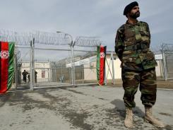 An Afghan National Army soldier stands in front of the gate of  Pul-e-Charkhy prison in 2007 in Kabul.