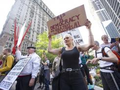 Alison Gordy demonstrates Monday in New York City, home of the &quot;Occupy Wall Street&quot; protest.