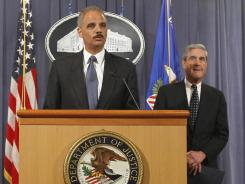 Attorney General Eric Holder, at a Tuesday news briefing, says the Saudi diplomat  was never in danger as the plot was monitored by U.S. agents. At right is  FBI Director Robert Mueller.