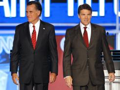 Former Massachusetts Gov. Mitt Romney and Texas Gov. Rick Perry during a Republican presidential debate in Sept.