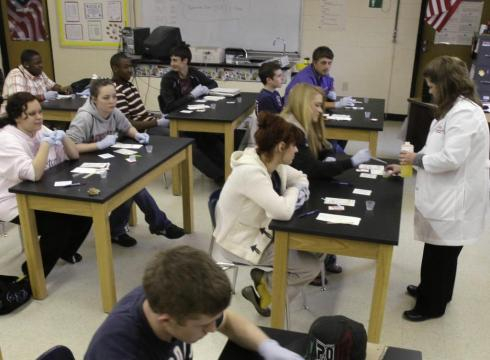 Sparkman High School students work in a science class in Sparkman, Ark., in