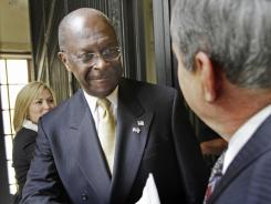 Republican presidential candidate Herman Cain greets state lawmakers in New Hampshire on Wednesday.