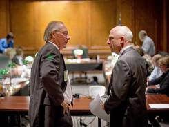 John Grant, chief investigator for the Georgia Professional Standards Commission, right, speaks to incoming director of the ethics division Paul Shaw, after the commission voted to yank the teaching licenses of eight teachers and three school administrators accused in the Atlanta schools cheating scandal on Thursday.