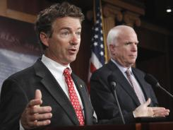 Sen. Rand Paul, R-Ky., left, discusses the introduction of a Republican jobs bill Thursday as Sen. John McCain, R-Ariz., listens.