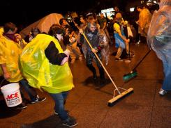 Demonstrators affiliated with the Occupy Wall Street protests sweep Zucotti park to pre-empt a scheduled cleanup by owners Friday morning that protesters say is a move to shut them down.