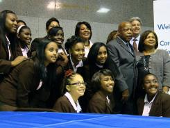 The Rev. Bernice King and Rep. John Lewis, D-Ga., pose with a group of 10 students from the Coretta Scott King Young Women's Leadership Academy in Atlanta after their arrival in Washington's Union Station. The students will be in D.C. for the weekend leading up to the dedication of the MLK Memorial.