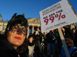 Demonstrators take part in protests against the power of the financial markets in front of the Reichstag in Berlin on Sunday.