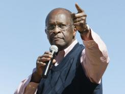 GOP hopeful Herman Cain addresses the crowd in Bartlett, Tenn., on Friday.