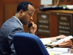 Conrad Murray looks over notes during trial at the Los Angeles Superior Court.
