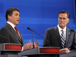 Former Massachusetts governor Mitt Romney, right, listens as Texas Gov. Rick Perry makes a statement during a debate on Sept. 22.
