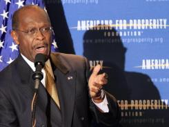 Herman Cain speaks during an April dinner sponsored by Americans for Prosperity.
