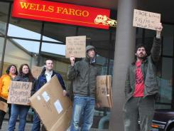 Protesters rally outside a bank Saturday as part of Occupy Juneau protest in Alaska.