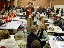 Precinct Chairwoman Judy Wittkop explains the rules during the Jan. 3, 2008, caucus in Le Mars, Iowa.