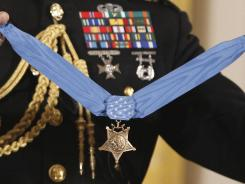The Medal of Honor is held by a military honor guard as the citation is read last month.