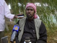 Ali Mohamud Rage, spokesman for Somalia's most dangerous militant group, holds a news conference in Mogadishu.