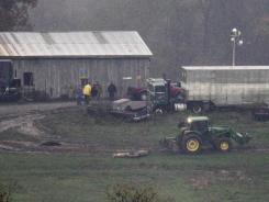 An animal carcass is dragged for burial at the Muskingum County Animal Farm on Wednesday in Zanesville, Ohio.