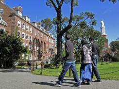 People walk through Brooklyn College in New York earlier this month. A new federal law requires university websites to include a net price calculator to help parents get a more accurate estimate of expected costs.