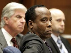 Dr. Conrad Murray, center, has pleaded not guilty and faces four years in prison and the loss of his medical license if convicted of involuntary manslaughter in Michael Jackson's death.