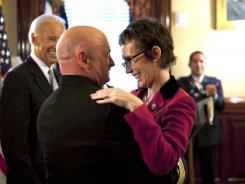 Mark Kelly hugs his wife Rep. Gabrielle Giffords, D-Ariz., after he received the Legion of Merit from Vice President Biden during Kelly's retirement ceremony on Oct. 6.