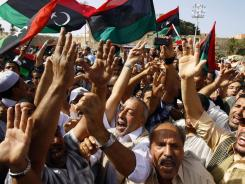 Libyan celebrate after the Muslim Friday prayer at Martyrs Square in Tripoli on Friday.