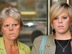 Sally and Gemma Dowler, mother and sister of murdered British school girl Milly Dowler, in July during legal proceedings.