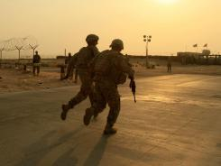 U.S. soldiers race toward the border from Iraq into Kuwait in this 2010 photo.