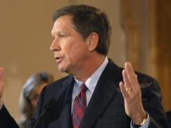 Ohio Gov. John Kasich speaks during a news conference before signing an executive order on dangerous exotic pets Friday.  Kasich said he'll push for a moratorium on exotic animal auctions and a crackdown on unlicensed auctions.