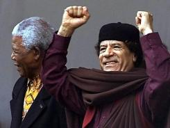 In this July 9, 2002, photo, Libyan leader Moammar Gadhafi, right, stands with former South African President Nelson Mandela at the launch of the African Union (AU) in Durban, South Africa.