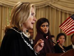 U.S. Secretary of State Hillary Clinton, left, speaks as Pakistan Foreign Minister Hina Rabbani Khar looks on during a joint news conference Friday in Islamabad.