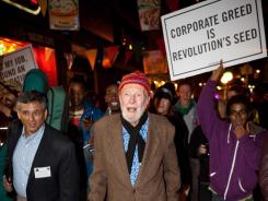 Activist- musician Pete Seeger, 92, center, marches with Occupy Wall Street protesters.