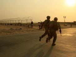 U.S. soldiers race toward the border from Iraq into Kuwait in August 2010. President Obama has declared an end to the Iraq war, one of the longest and most divisive conflicts in U.S. history.