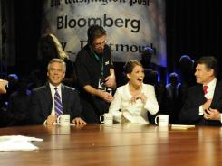 From left, Jon Huntsman, Michele Bachmann and Rick Perry at a debate Oct. 11.